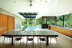 The pool, kitchen and dining areas are completely open to the garden.
