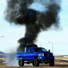 Blue Dodge lifted Cummings lifted truck smoking coal