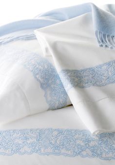 Juliet:  In an intricate display of pure craftsmanship, the borders of our hand-embroidered design frame these bed linens in a subtle style, at home in both traditional and contemporary settings. Shown on a 50% lambswool/50% cashmere throw.