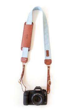 The Sky Fotostrap - an airy light blue canvas and leather camera strap!  All Fotostraps are made in the USA, 10% of proceeds are donated to Fotolanthropy, and offer custom monogramming to the leather shoulder pad.  Add your name, initials, monogram, or even a business logo!  Shop at www.fotostrap.com.