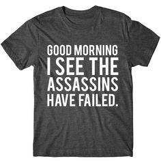 Metallic Gold Print Good Morning I See the Assassins Have Failed... ($14) ❤ liked on Polyvore featuring tops, t-shirts, black, women's clothing, t shirt, sleeve t shirt, glow in the dark t shirts, cotton shirts and print t shirts