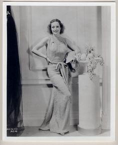 Joan Crawford (gown by Schiaparelli)
