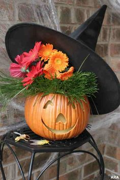 I choose this cutie because it would be a really cute centerpiece for Halloween. I could carve what ever cute pumpkin face and I love the witch hat and fall flowers. Very cute idea! Simple too so kids could help to create.