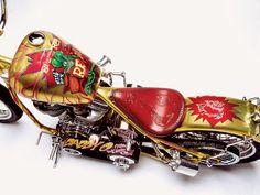 Year: 2003 Builders: Indian Larry Motorcycles Engine: 88 ci Pandemonium Front End: Indian Larry Twisted Springer Paint: Robert Pradke, Gold Metal Flake