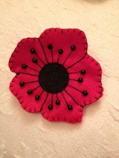 felt poppy. all money raised going to the British legion