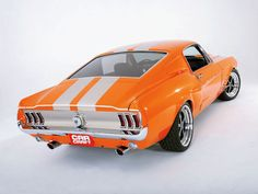 Mustang fastback 1967. Great Tango Orange, (but I don't care for the low profile rubber band tires)..