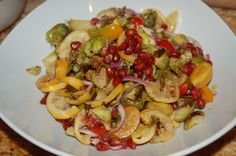 Roasted Brussels Sprouts with Lemon & Pomegranate.  Celebrate winter's vegetables and fruits.