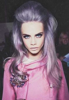 Cara D looking pretty in pink and purple...