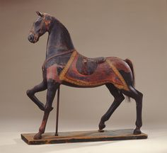 American Horse, ca. 1880. Carved and assembled wood with painted canvas, glue, leather, glass eyes, horsehair tail, board, metal pole and studs