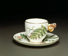 Cup and saucer Place of origin:Stoke-on-Trent, England (made) Date: 1897 (made) 1869 (designed) Artist/Maker: Minton & Co. (manufacturer)Materials and Techniques: Bone china, transfer-printed, with enamel painting and gilding Museum number: CIRC.67 cup and saucer are part of a relatively expensive service made of Minton's very high-quality bone china and are skilfully painted. V