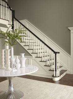 Entryway in a neutral paint colors palette. Benjamin Moore Stonington Gray stair risers, trim and wainscoting, walls Lacey Pearl, accent Almost Black Neutral Paint Colors, Interior Paint Colors, Foyer Paint Colors, Beige Paint, Shades Of Brown Paint, White Colors, Stain Colors, Vestibule, Room Colors