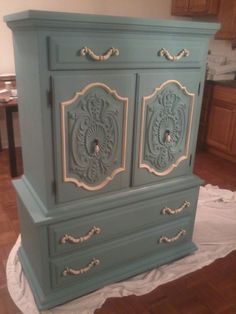 I painted this dresser using Annie Sloan Chalk paint Provence with Cream...lovely!
