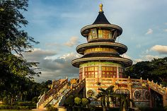 Kanchanaburi Chinese temple Wat Thawonwararam in golden evening light.     Chinese temples often have beautiful artistic qualities.