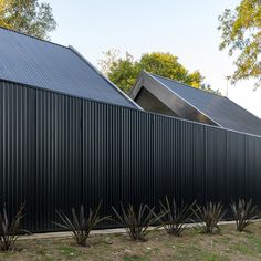 house, 'la negrita,' is nestled among a forest in argentina -m.black house, 'la negrita,' is nestled among a forest in argentina -m. Black Shed, Black Barn, Black House Exterior, Interior Exterior, Modern Barn House, Exterior Cladding, Metal Cladding, Minimalist House Design, Modern Farmhouse Exterior