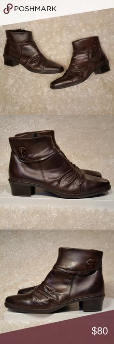 Rieker Kendra Brown Leather Ankle Boots Size 42 Rieker Kendra Brown Leather Ankle Boots Good pre-loved condition. Side zip, button detail. Genuine leather Euro size 42 / US Size 10 *Brand-specific shoe size conversions all from http://www.shoesizechart.us/* *Offers welcome!* Rieker Shoes Ankle Boots & Booties