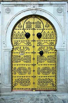 Door in Tunisia - photo by Mohannad Khatib, via Flickr    https://www.flickr.com/photos/mohannad_khatib/4577396765/in/photostream/