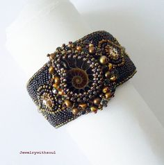Chocolate bead embroidery cuff bracelet with ammonite shell cabochon in coffee brown, gold and bronze.