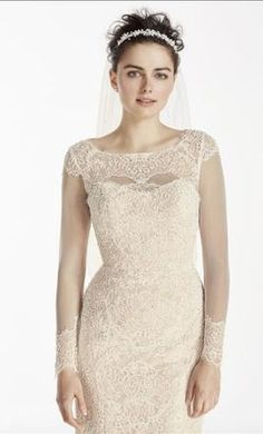 Oleg Cassini CWG712 12: buy this dress for a fraction of the salon price on PreOwnedWeddingDresses.com