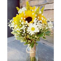 Sunflower Brides bouquet with baby's breath, daisies, solid, pit and twine.