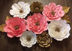 This listing is for a set of 8 paper flowers and 4 gold leaves. Included will be 5 large 17 in. flowers and 3 medium 12 in flowers. Three large flowers will come in different shades of pinks, two medium flowers will come in gold and one medium flower will come in white. All the