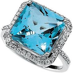 Diamonds and A beautiful blue topez stone in the center. onlysirene