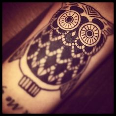 Owl Tattoo...simple, girly and cute. I think i'd change the eye design...and I DEFINITELY want color.