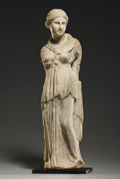 A STATUETTE OF A GODDESS (ISIS?) H. 40.2 cm. Marble. Greek, 3rd cent. B.C.