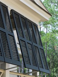 Two side-by-side four panel Bermuda or Bahama shutters.