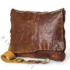Campomaggi Leather Messenger Bag with metal studs  One zipped inside pocket  Cell phone pocket  Adjustable canvas shoulder strap  Average shoulder strap drop: 36 - 66cm  Cotton lining