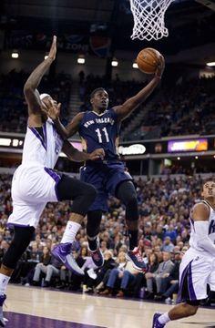 Sacramento Kings center DeMarcus Cousins, New Orleans Pelicans guard Jrue Holiday