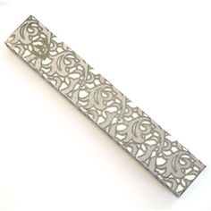 This mezuzah was hand-crafted in Israel from stainless steel and lace fabric. The art of lace on metal is what decorates this mezuzah and what makes it a beautiful collectable and a timeless keepsake.