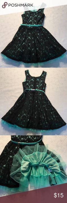 NWT Beautiful girls black lace w/mint green dress. NWT Beautiful girls size 7/8 black lace dress with a mint green liner and layer of mint green toule that shows at the bottom of the dress. It has a matching mint green belt. This can be worn for any occasion. I bought this for my daughter, but she never got a chance to wear it! :( The belt had a crack underneath when I bought it. You cannot see it from the outside. I took a picture of it. Beautees-designed in Los Angeles Dresses Formal