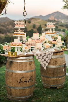 Create a rustic feel for your dessert table using old wooden wine barrels and a vintage lace doily as a tablecloth.