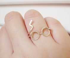 @jen Grant  Harry Potter Ring - Glasses Ring, Lighting Scar - Sterling Silver Wire Wrap Ring, Adjustable - Cool, Funny, Geeky Gift for Friend. $25.00, via Etsy.