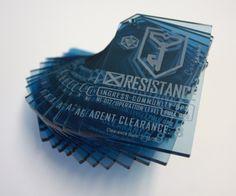 Personalised Ingress Badges, laser engraved from transluscent blue acrylic. ArtisanModelMakers.