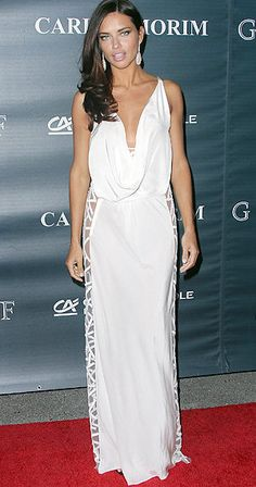 Adriana Lima donning a dress backwards, showcasing her amazing décolletage.
