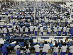 Workers prepare MOTO X smartphones on the factory floor at the Flextronics factory plant in Fort Worth, Texas on Sept. 9. The factory is the...