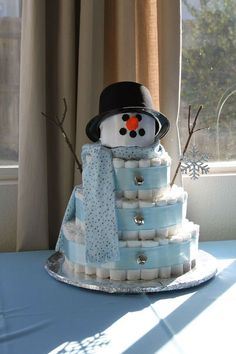 Snowman diaper cake for winter or holiday baby shower