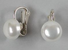 These delicate classic shell pearl clip on earrings are the smartest jewellery accessory. http://www.annabelchaffer.com/products/Clip-On-Earrings.html