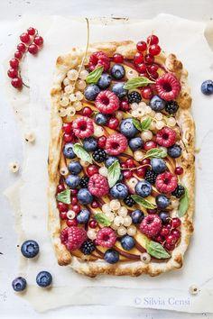 fruit cake with redberries, blueberries, raspberries and peaches (fruit tart dessert)