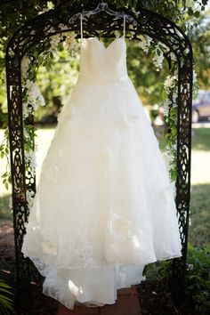 Love the idea of taking photos of just Brieanna's Wedding Dress the day of with her decor outside.