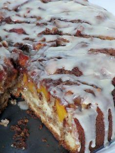 Vanilla Peach Coffee Cake  **eggs, milk, oil, vanilla, sour cream, flour, sugar, baking powder, baking soda, peaches, butter, brown sugar, cinnamon, nutmeg, flour, powdered sugar, heavy cream