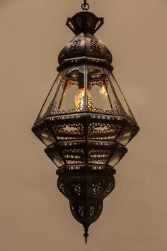 Moroccan Clear Glass Lantern | From a unique collection of antique and modern chandeliers and pendants  at https://www.1stdibs.com/furniture/lighting/chandeliers-pendant-lights/