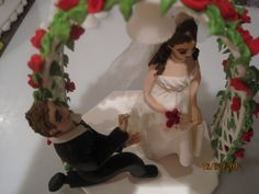 Groom proposing sugar cake topper.  An original hand made sugar art piece by Tania Riley.  Johannesburg, South Africa.  0829316200