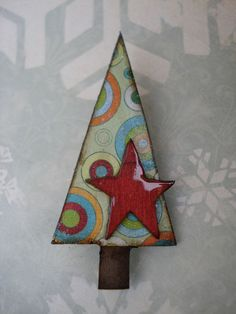 perk up your hat, sweater, scarf or coat with this festive holiday pin!    composed of paper mache pieces, collage papers, ink, acrylics, gloss and bits of glitter glaze. it measures approx 2 1/2 inches tall and 1 1/4 inches wide. sealed with layers of matte and satin varnishes and a light layer of sparkle glaze and glossy red star.    arrives festively wrapped inside a bubble mailer and ready to wear or share :)    makes a lovely teacher, nurse, or co-worker gift too :)    thanks for…