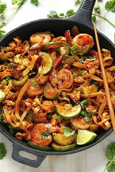 Spicy Sriracha Shrimp & Zucchini Lo Mein - 8 oz. package Lo Mein Noodles, 2 Tbsp Olive Oil, 1 Tbsp Butter, 1/2 lb. Shrimp (peeled and deveined), 1 medium Zucchini (cut in half vertically, then cut into half moon shapes), 3 cloves Garlic (minced), 1/2 Tsp crushed Red Pepper Flakes, 2 large Eggs (lightly beaten), 1 Tbsp Brown Sugar, 2 1/2 Tbsp Soy Sauce, 2 Tbsp Sriracha Sauce, 1 Tsp grated Ginger, 1 Tsp Sesame Oil, 1/2 cup fresh Cilantro, 3 Green Onions (sliced thinly), Salt to taste (IF…