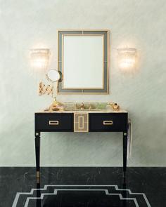 Walton come un abito di  haute couture veste il tuo bagno con ricche finiture in oro, onice prezioso, specchi fumé e  laccature pregiate.
