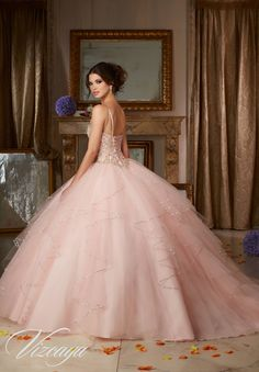 Quinceañera Ballgown featuring a Sweetheart Neckline and Corset Back. Flounced skirt accented with beading. Colors: Aqua/Gold, Blush/Gold, Coral/Gold, White