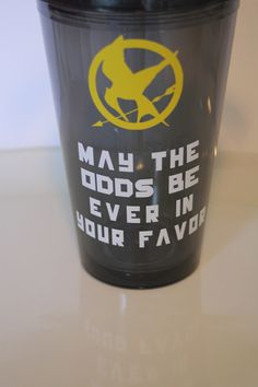 HUNGER GAMES insulated tumbler. May the Odds be Ever in your Favor. Cup. Add a name or monogram.. $12.50, via Etsy.