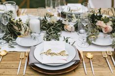 Rustic engagement party place settin with modern flatware and laser cut name cards